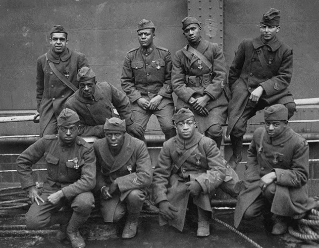 "Photo courtesy of the National Archives. Harlem Hellfighters shown pictured wearing their ""French Croix de Guerre"" Medals"